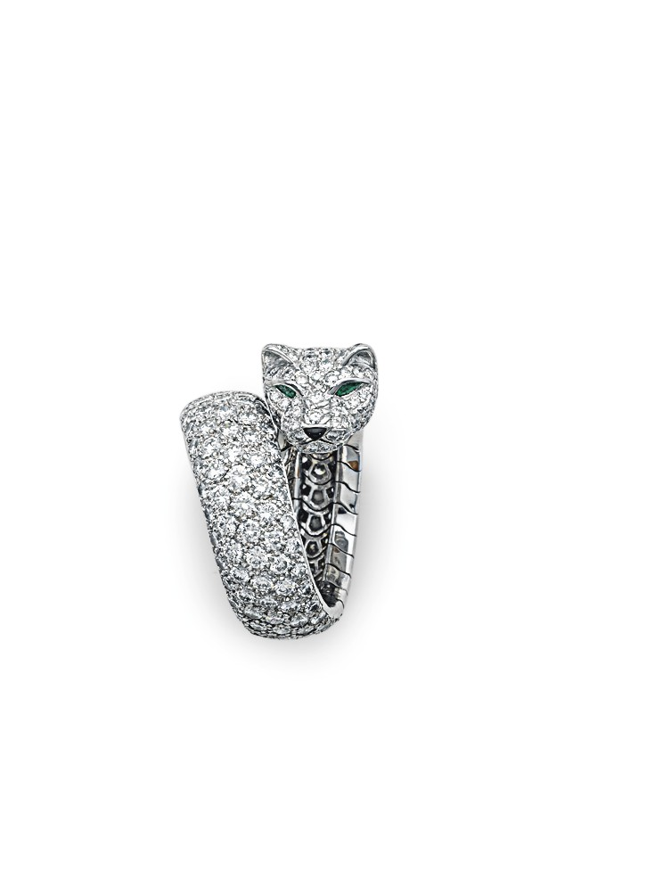 "A DIAMOND, EMERALD AND WHITE GOLD ""PANTHÈRE"" RING, BY CARTIER ESTIMATE: $40,000 – $50,000"