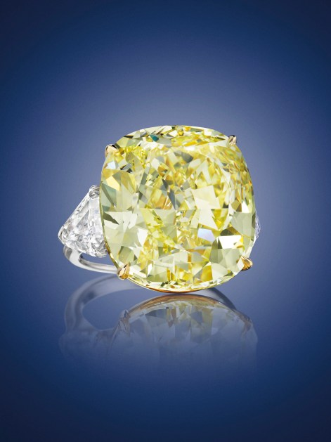 A CUSHION-CUT FANCY INTENSE YELLOW VS2 DIAMOND OF 28.02 CARATS ESTIMATE: $700,000 – $900,000