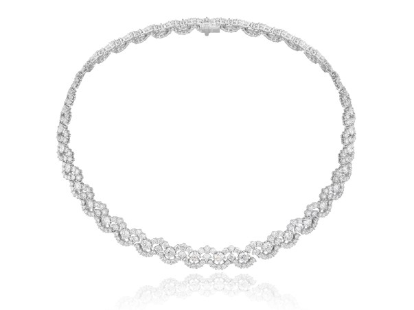 Green Carpet Collection necklace designed as a ribbon of diamond arabesques in 18ct white Fairmined gold set with brilliant-cut diamonds (19cts). All diamonds are sourced from a producer who is a RJC certified member. Ring and earrings en suite.