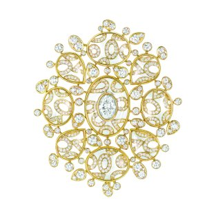 """""""Magnétique"""" brooch in 18K yellow gold set with a 1.6-carat oval-cut diamond, 460 brilliant-cut diamonds for a total weight of 6.1 carats and 18 cabochon-cut crystals for a total weight of 47.9 carats. CHANEL Joaillerie"""