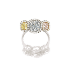 Set with a cushion-shaped light blue, fancy intense yellow and fancy light pink diamond weighing 1.33 carats, 0.50 and 0.40 carat respectively, framed by circular-cut diamonds, mounted in platinum and 18 karat pink gold.