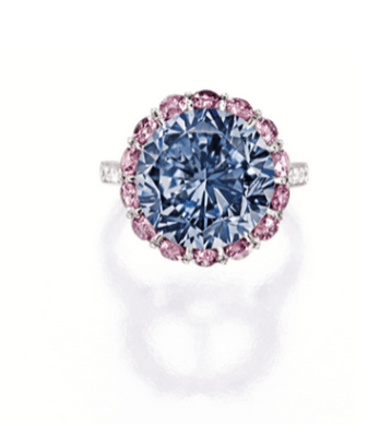 Centring on a brilliant-cut fancy vivid blue diamond weighing 7.59 carats, surrounded by brilliant-cut pink diamonds together weighing approximately 1.70 carats, to shoulders set with brilliant-cut diamonds, mounted in platinum.