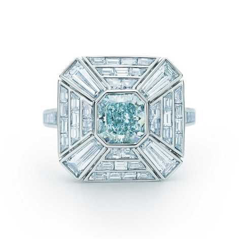Tiffany designers set a stunning greenish blue diamond at the center of this Art Deco-inspired ring. White diamonds in platinum create a mesmerizing frame. Rectangular modified brilliant Fancy Greenish Blue diamond, carat weight 1.20; square baguette white diamonds, carat total weight 2.09; round brilliant white diamonds, carat total weight .12.