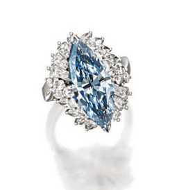 Centring ona marquise-shaped fancy grey-blue diamond weighing 4.37 carats, amidan elevated mount decorated with baguette, marquise-shaped and brilliant-cut diamonds together weighing approximately 2.80 carats, mounted in platinum.
