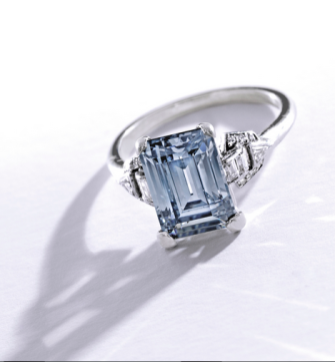 Centering an emerald-cut Fancy Grayish Blue diamondweighing 3.02 carats, the mounting accented by baguette, single, old mine and triangle-cut diamonds weighing approximately .30 carat, circa 1930.