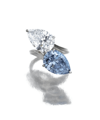 Of cross over design, set with a fancy vivid blue pear-shaped diamond weighing 5.02 carats and a pear-shaped diamond weighing 5.42 carats, to a platinum mount.
