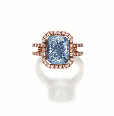The radiant-cut fancy intense blue diamond weighing 5.02 carats, set within a border of circular-cut pink diamonds, similarly accented to the shoulders, mounted in 18 karat pink and white gold.