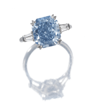 Claw-set with a fancy vivid blue cut-cornered rectangular modified brilliant-cut diamond weighing 4.16 carats, flanked by tapered baguette diamonds, mounted in platinum.