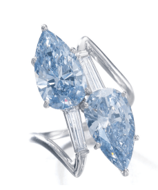 Oftoi et moidesign, set with two pear-shaped diamonds, one fancy vivid blue weighing 3.08 carats, the other fancy intense blue weighing 2.83 carats, between tapered baguette diamonds.