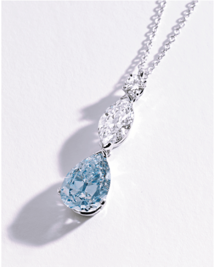 The pendant set with a pear-shaped diamond of fancy intense blue color weighing 2.59 carats, surmounted by a marquise-shaped diamond weighing.92 carat, and a round diamond approximately .10 carat, completed by a platinum, link chain.