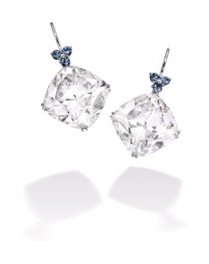 Important Pair of Platinum, Diamond and Sapphire Earrings. Suspending two cushion-cut diamonds weighing 29.39 and 28.03 carats, surmounted by round sapphires weighing 1.02 carats. Estimate: $1,650,000 — 1,850,000
