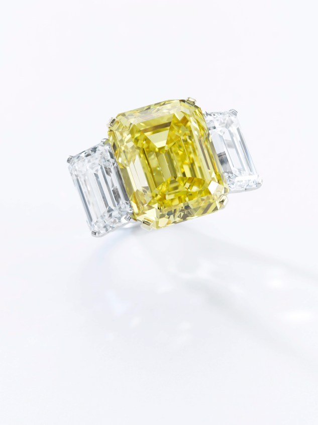 "A Fancy Vivid Yellow diamond ring: an extraordinary yellow diamond ring weighing 22.43 carats. The stone has been graded ""Fancy Vivid Yellow"" by the GIA, with VS2 Clarity. Estimate $1,300,000-1,600,000."