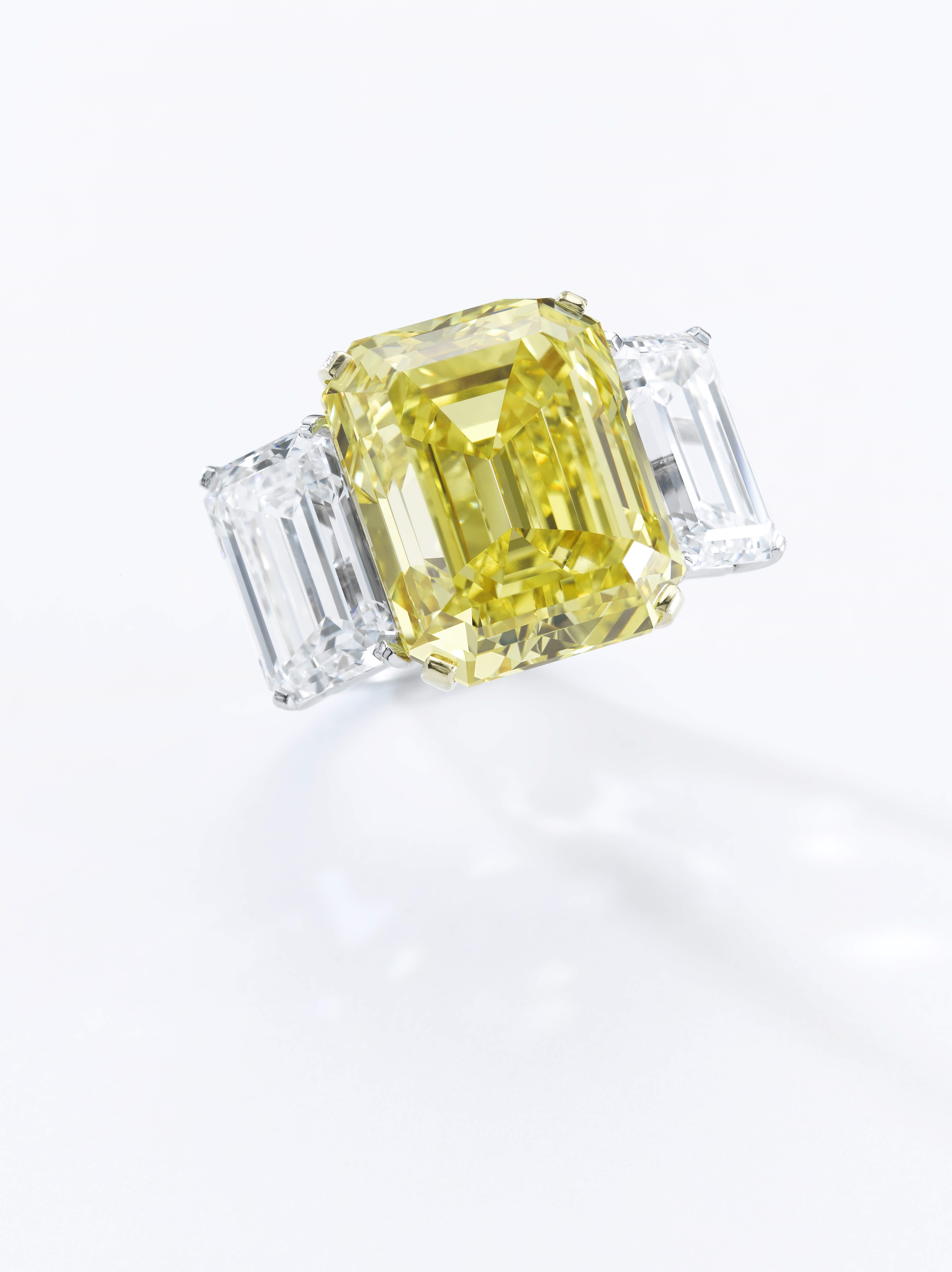 """A Fancy Vivid Yellow diamond ring: an extraordinary yellow diamond ring weighing 22.43 carats. The stone has been graded """"Fancy Vivid Yellow"""" by the GIA, with VS2 Clarity. Estimate $1,300,000-1,600,000."""