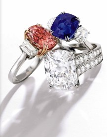 Three superb rings. Important 18 Karat White Gold, Sapphire and Diamond Ring Centering a cushion-cut sapphire weighing 9.11 carats, flanked by two cushion-cut diamonds weighing 1.06 and 1.01 carats, size 6. Estimate: $750-1,000,000. Platinum and Diamond Ring, Cartier Centering a cushion-cut diamond weighing 15.04 carats, flanked by diamond-set rows, the round diamonds weighing approximately 1.25 carats, size 8, signed Cartier, numbered 891956. With signed box. Estimate: $700-900,000. Platinum, 18 Karat Rose Gold, Padparadscha Sapphire and Diamond Ring Centering a cushion-cut padparadscha sapphire weighing 9.12 carats, flanked by trapeze-cut diamonds weighing approximately 1.05 carats, size 5¾. Estimate: $100-150,000.