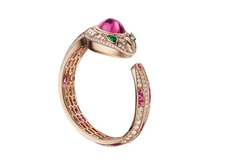 Bulgari Serpenti Seduttori. High Jewellery bangle watch, 18kt pink gold curved case set with brilliant-cut diamonds, 1 cabochon cut tourmaline and 2 pear-shaped emeralds; 18kt pink gold dial set with brilliant-cut diamonds; 18kt pink gold bracelet set with brilliant-cut diamonds and baguette-cut tourmalines.