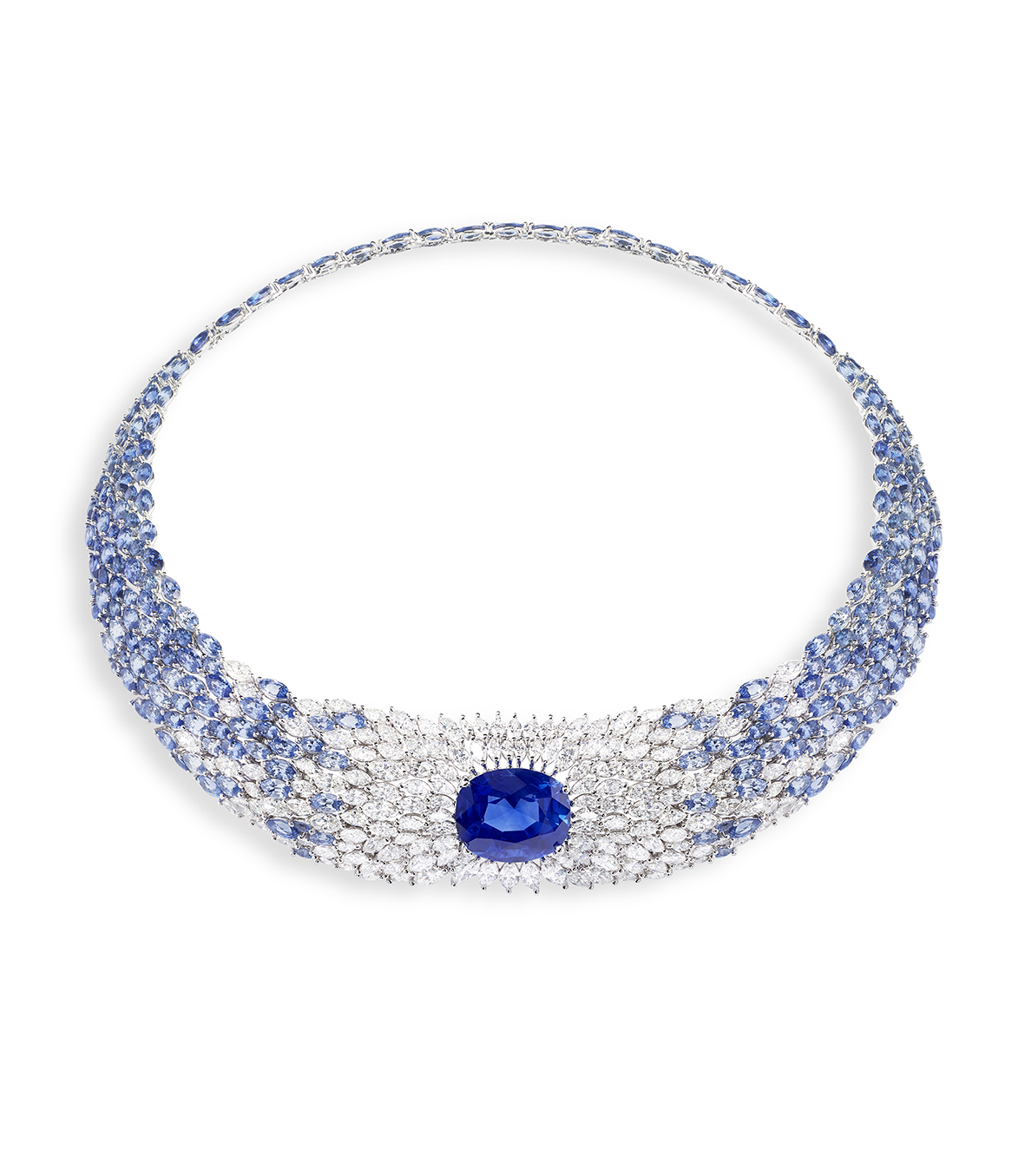 Sea Temptation Necklace. Necklace in 18k white gold set with 1 oval-cut blue sapphire from Ceylon (approx. 22.68 cts), blue sapphires and diamonds.