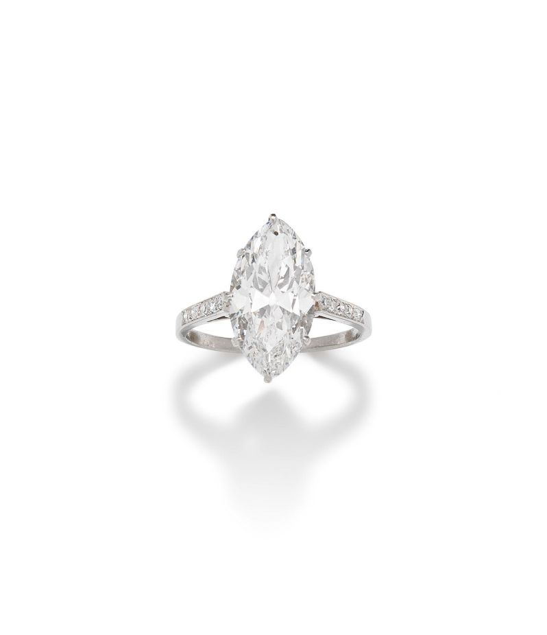 An old marquise-cut diamond single-stone ring, weighing 4.61 carats, is D colour, VVS2 clarity