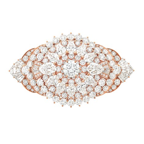 Van Cleef & Arpels - Le Secret High Jewellery Collection. Coeurs Enlacés Bracelet. Pink gold, diamonds, pink and yellow sapphires, rubies, spessartite garnets, 3 cushion-cut pink spinels for a total of 31.17 carats. Detachable clips.