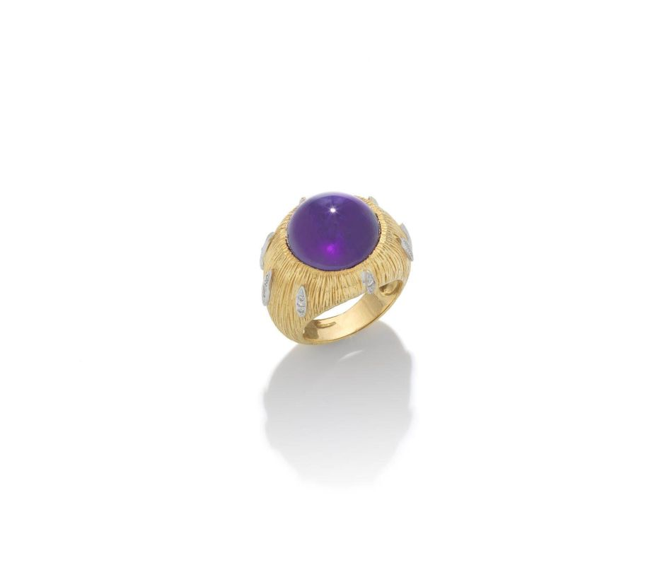An Amethyst and Diamond Ring by Grima. Lot 85