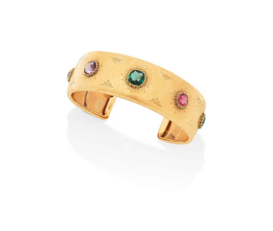 A varicoloured gold and multi gem-set bangle, by Mario Buccellati