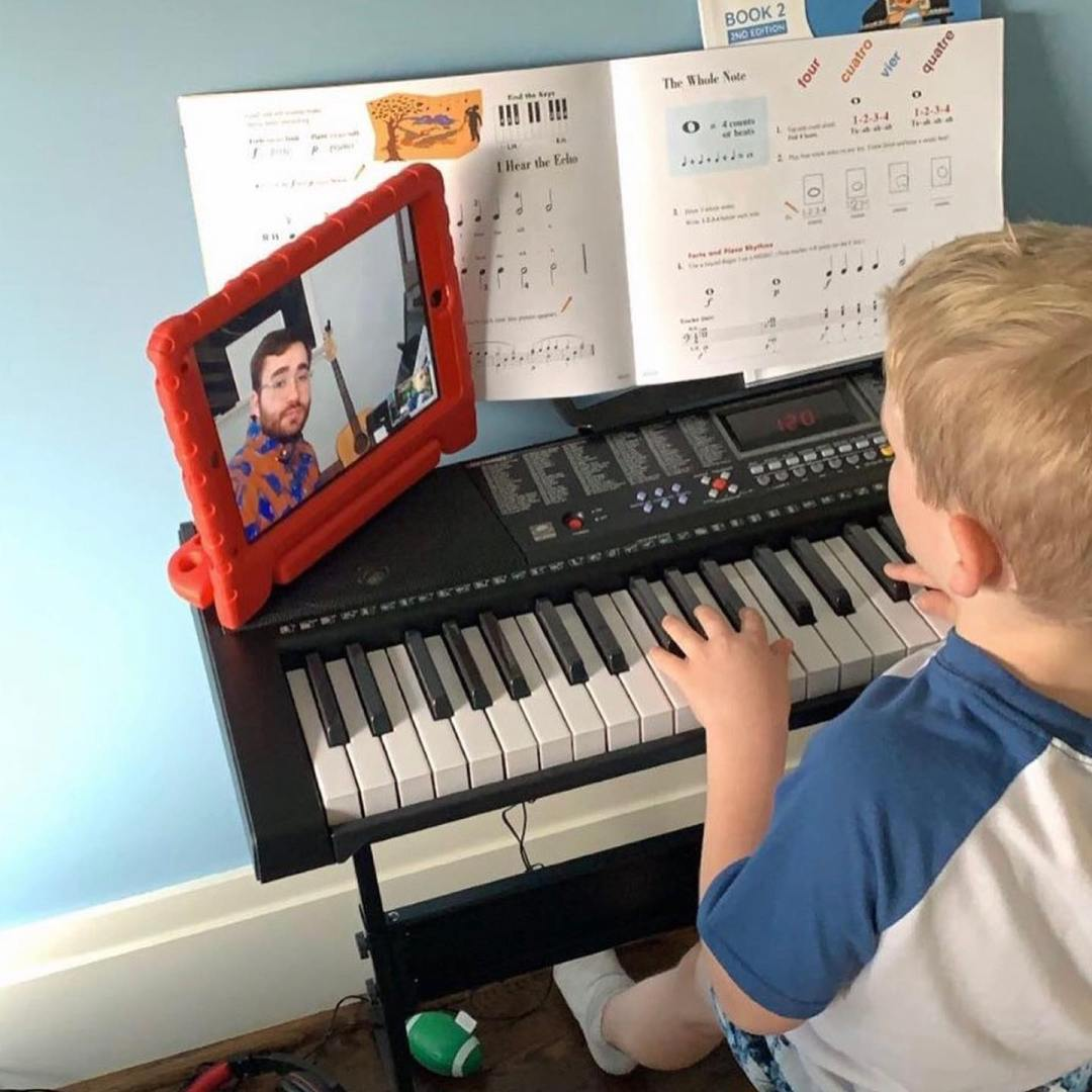 child taking music lessons online