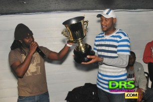 DJ Nolan accepting the trophy from Randy Fyah of King AP