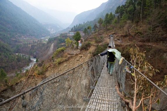 The first suspension bridge crossing between Lukla and Phakding