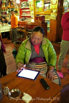 The Panorama Hotel in Namche Bazaar was a welcome stop and had the luxury of hot showers and electric blankets. The food and service here was excellent. The owner's wife spotted here playing with an iPad.