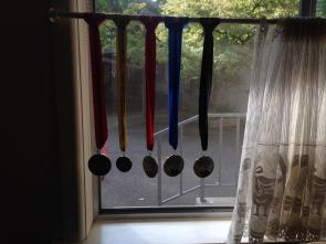 All the bling including Tallis' mini-medallion