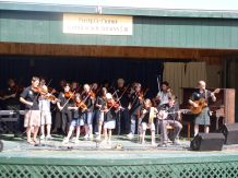 View of Fiddle group from Scotland on stage