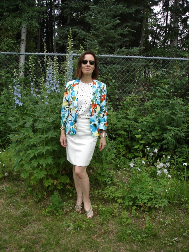 over 50 years old style blogger with a floral blazer and white leather skirt