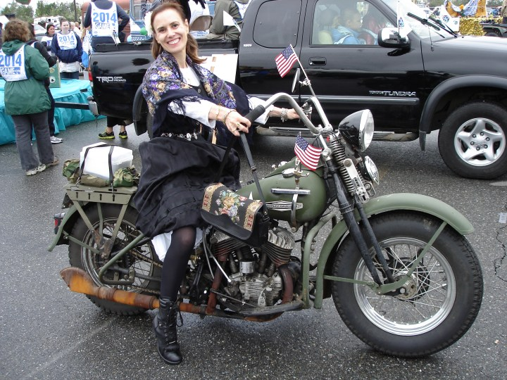 Nicole in a historic costume on a World War II Harley Davidson in a Golden Day costume