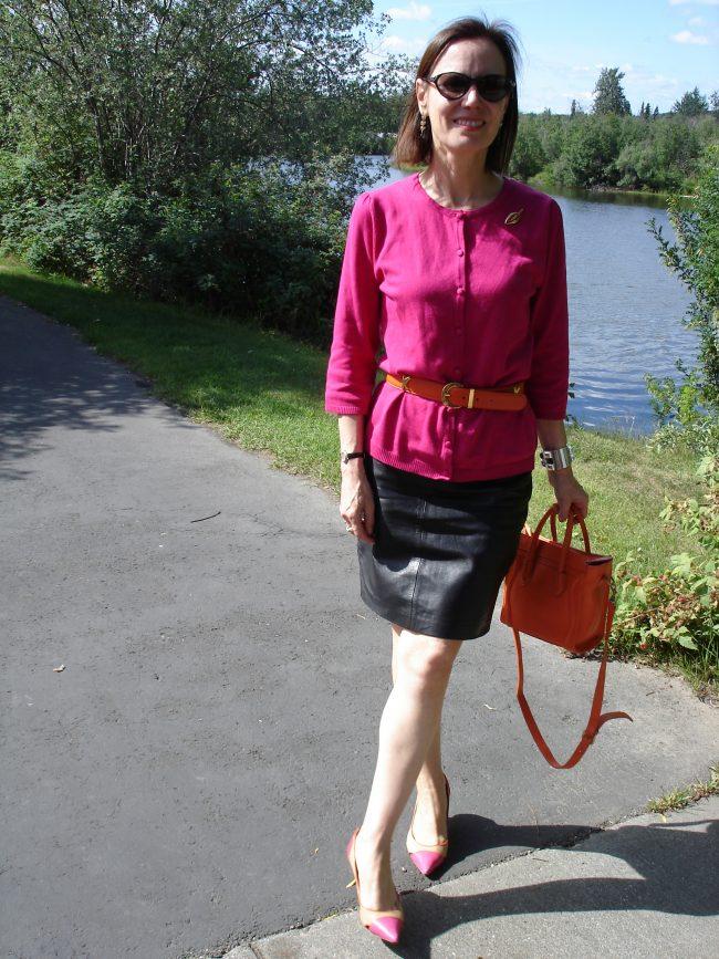 fuchsia cardigan, orange belt bag, leather skirt, cap toe pumps