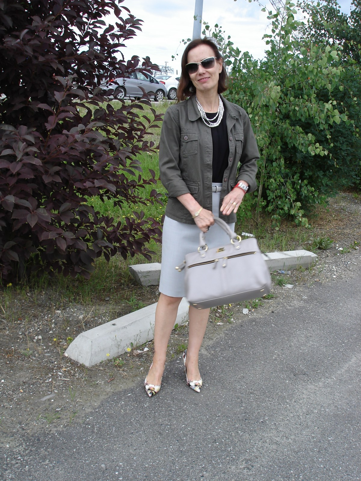 fashion  blogger over 50 in pencil skirt and safari jacket