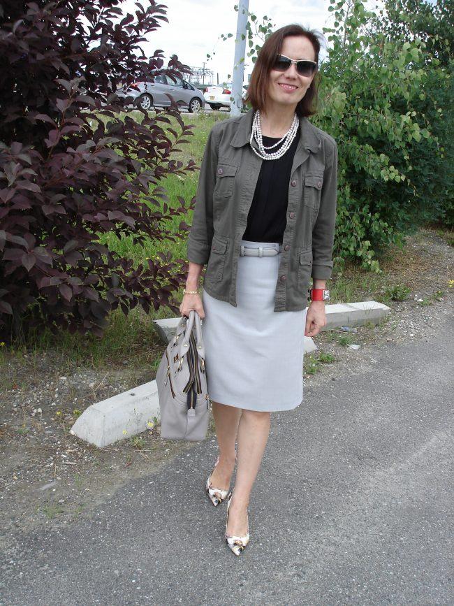 stylist in skirt, top, jacket, pumps