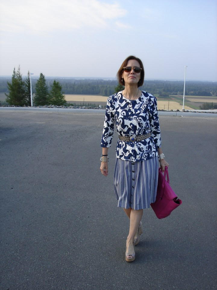 over 50 years old style blogger wearing a traditional dress as skirt with an ethnic belt