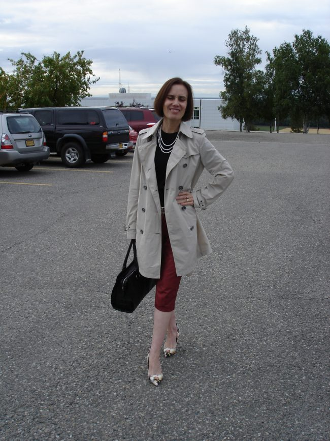 fashion blogger in trench coat, cropped burned red leather pants