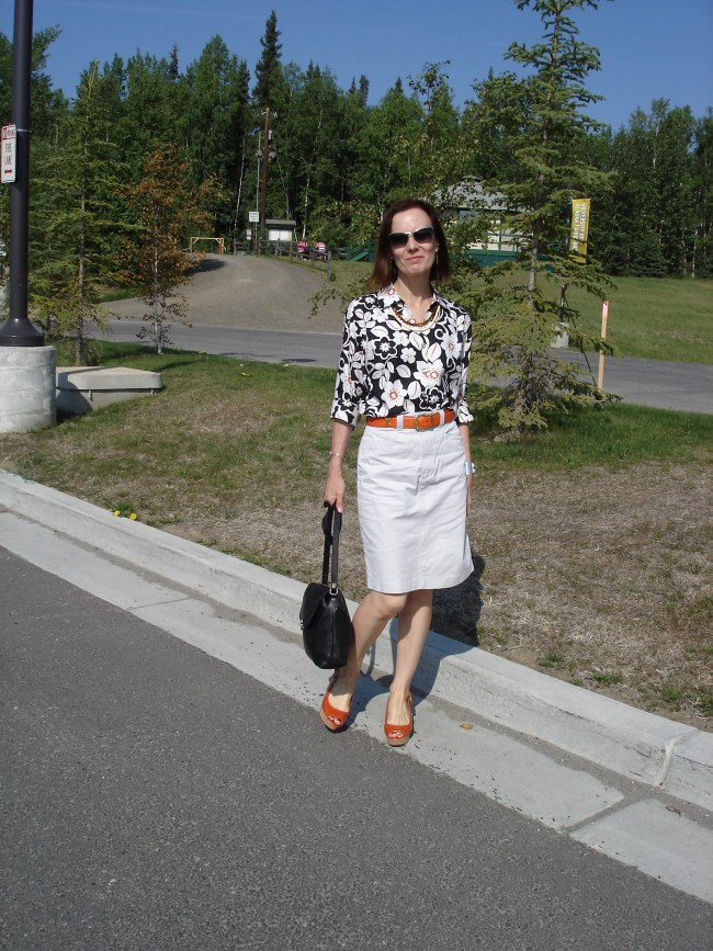 fashion blogger over 50 in Hawaiian shirt and denim skirt