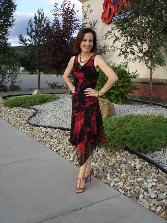 midlife woman in floral asymmetric hem dress