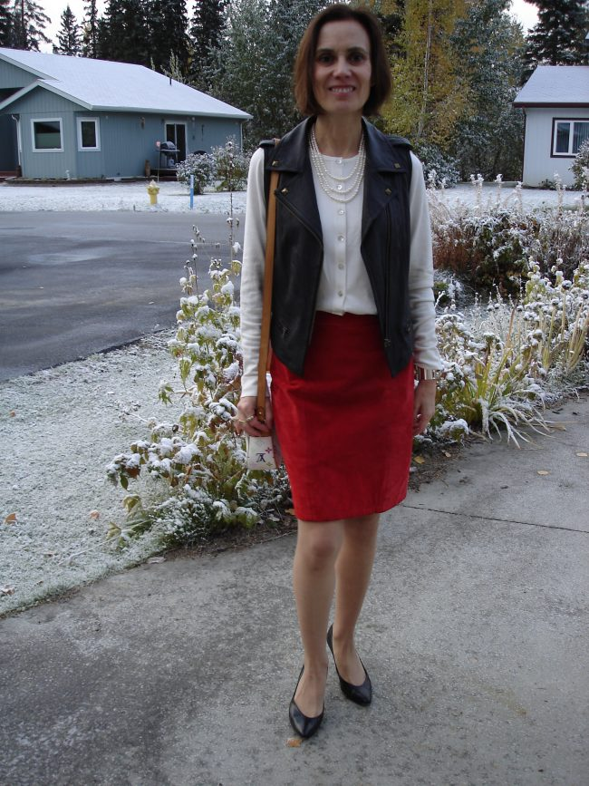 Alaskan blogger in vest, skirt and top in fall
