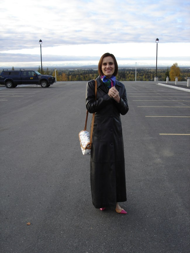 #fashionover40 mature woman in long leather coat