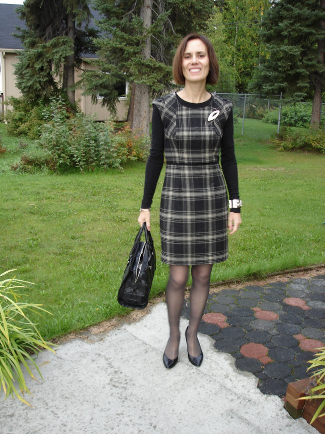 style book author in plaid sheath