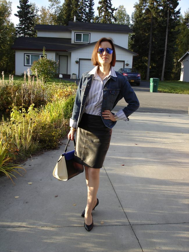 stylist in all neutral look with skirt, blazer, shirt