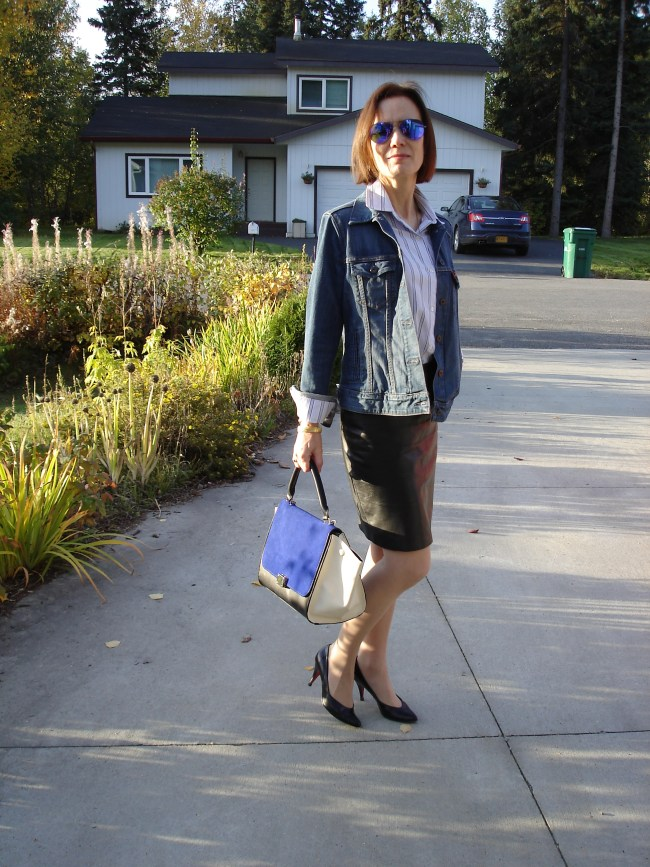 styler blogger in leather pencil skirt, oversize denim jacket and striped button-down shirt in all neutral colors
