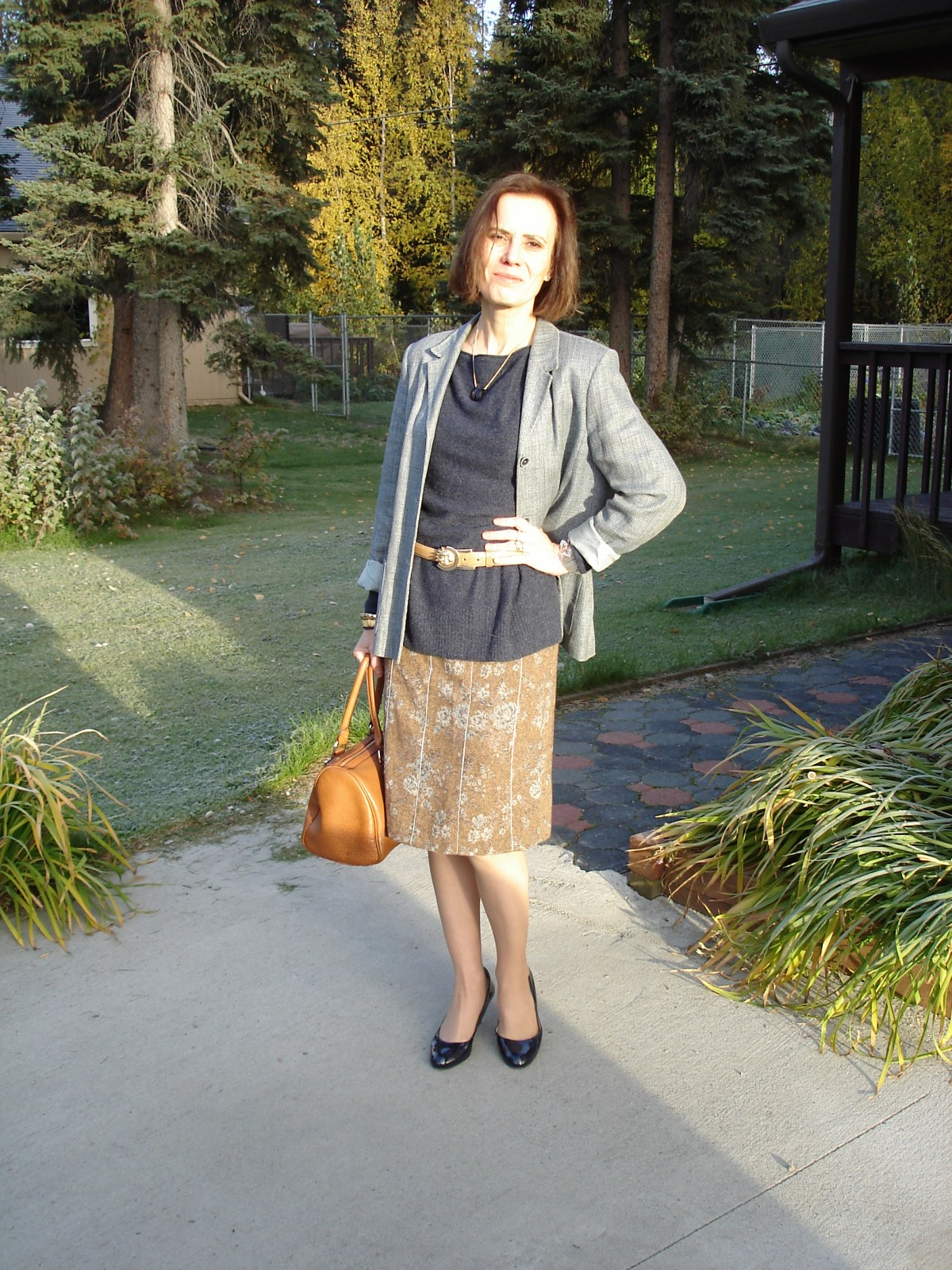 midlife style blogger in tweed skirt with blazer as unmatched suit for work