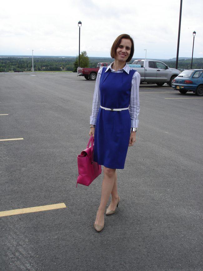 stylist in purple sheath on a gray day
