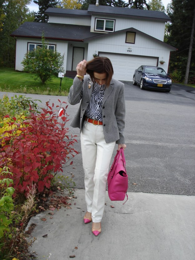 style blogger over 50 showing how to wear animal print