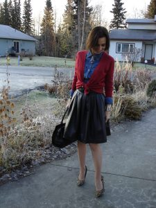 See how to style a full leather skirt over 50