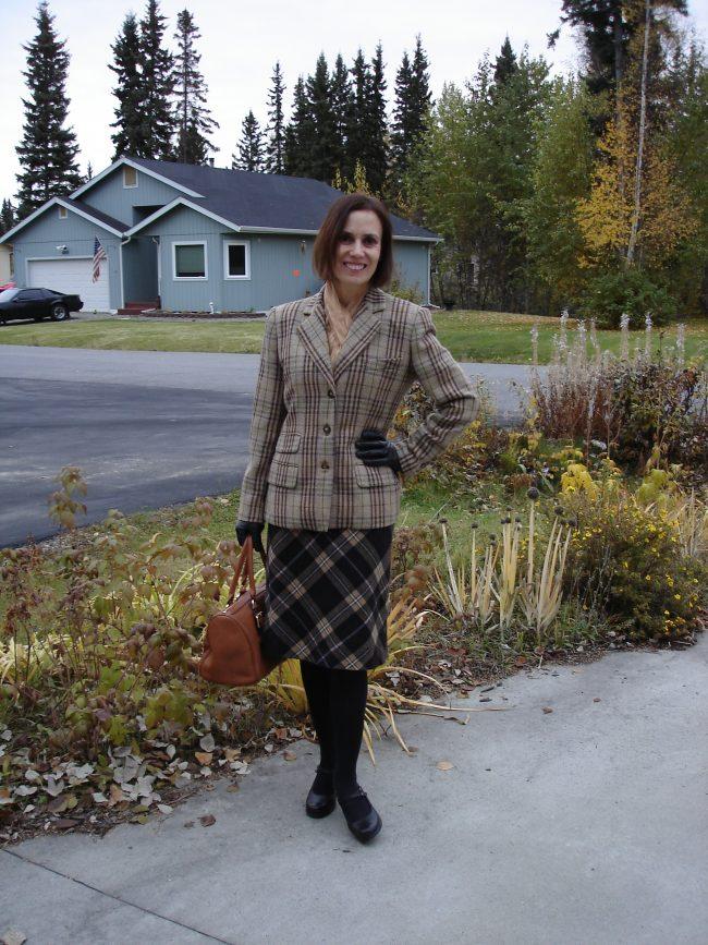 influencer in plaid blazer and bias plaid skirt
