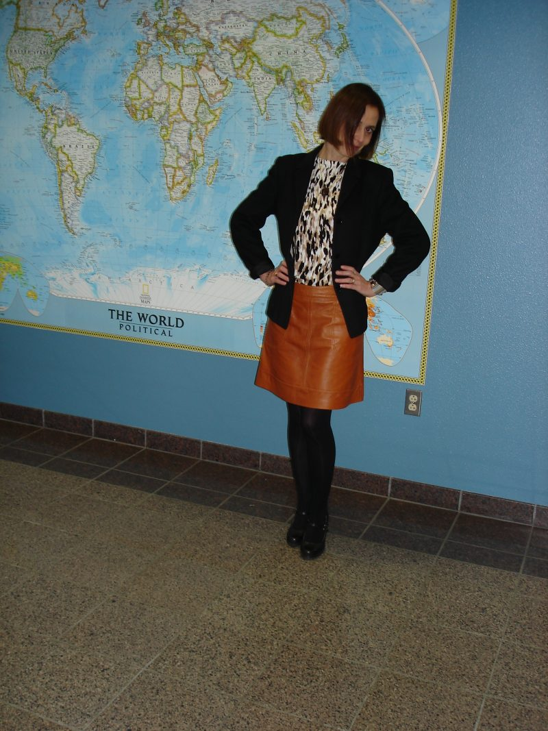 over 50 years old fashion blogger wearing a cardigan, blazer, leather skirt fall outfit